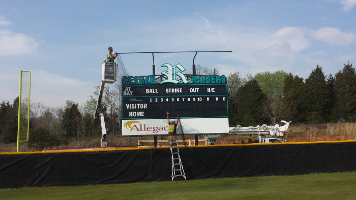 LED Baseball Scoreboard Installed with Protective Net structure and illuminated truss sign