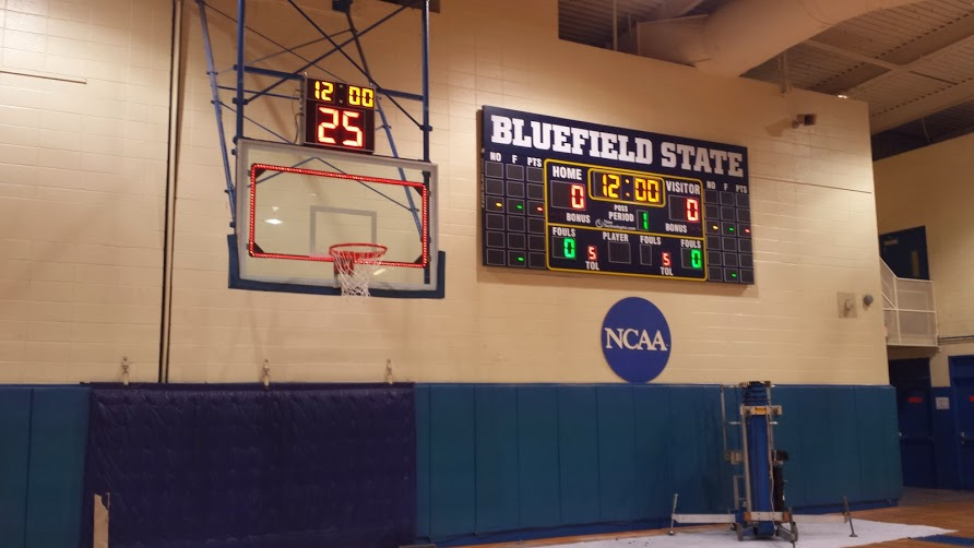 BB-1636 Basketball Scoreboard with 6 Player Stat panel and stadium ID sign.  Visual Goal Light indicators connected with Shot Clocks with Game Timer.